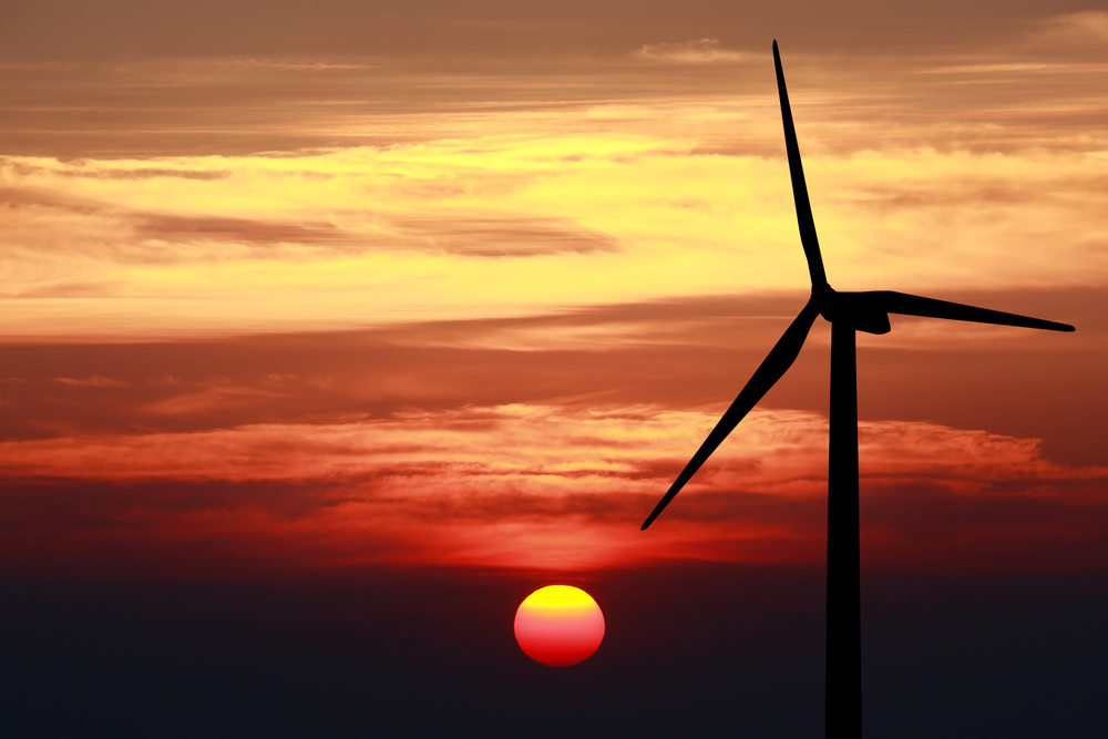 Sun Set behind wind turbine